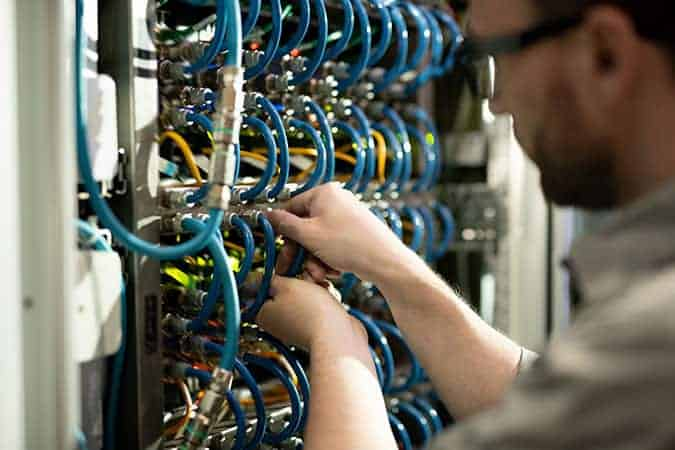 System Maintenance person fixing server